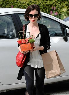 Lily Collins leaving the store Bristol Farms in Los Angeles, March 10, 2016
