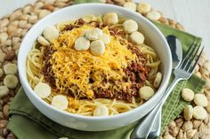 Cincinnati Chili With Water, Ground Beef, Crushed Tomatoes, Onions, Garlic, Chili Powder, Cider Vinegar, Worcestershire Sauce, Cocoa Powder, Salt, Cayenne Pepper, Ground Cumin, Cinnamon, Ground Cloves, Bay Leaf, Spaghetti, Cheddar Cheese, Oyster Crackers