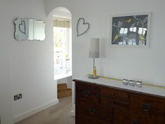 HOME RESTYLER: Before & After: yellow, grey & white living area