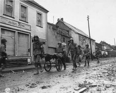 Medical troops transport wounded soldiers back to the Aid Station using a Collapsible Field Carrier