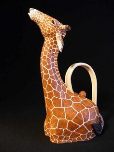 Christy Crews Dunn ( ), American / hand thrown and carved giraffe teapot ... head at the end of long neck forms spout, c. 2015, fired stoneware, USA