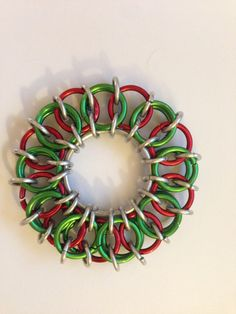 Handmade chainmaille wreath keychain. 2.5 diameter. Made from aluminum, red, and green aluminum. Custom colours available for other holidays! please