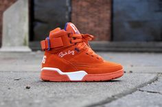 """Just when you thought Ewing Athletics had stopped turning heads, think again. The Ewing 33 Hi """"Orange Suede"""" in all of its glory is heading to very select retailers tomorrow. Going on sale February 2, 2013, the sneaker , with an all-orange suede upper and New York Knicks-inspired blue accents, is certainly looking to be the most anticipated yet of the Ewing troop. For a complete list of retailers where you can cop, click here."""
