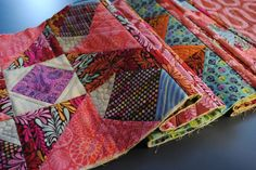 If you are following the Quilt~as~you~Go method this post covers joining the blocks into rows.  We will: 1 Cut the fabric sashing strips for joining blocks. 2 Join the blocks and spacers into rows …