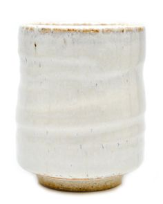 "Leifshop Organic Glaze Cup $16.00    With a creamy, rustic glaze and a sand-textured clay base, this roomy cup boasts a freeform, organic shape.       -  Ceramic     -  4"" tall x 3"" wide     -  Dishwasher and microwave safe     -  Made in Japan"
