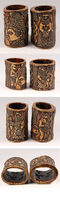 Nigeria | Pair of cuffs from the Yoruba people | Elephant ivory, old copper repairs to interior | 18th century | 4,000$ ~ sold (Mar '13)
