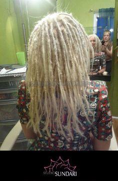 Natural hair dreadlocks bleached & toned platinum blonde.