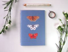 notebook with orange and blue butterfly print, by StudioEllenL on etsy