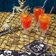 Give your Halloween party a pirate adventure twist by decorating with Skull Goblets, napkins and table covers that recall the Jolly Roger, plus netting, daggers and doubloons.    Serve a classic cocktail like Blood & Sand, which is sure to satisfy the thirstiest pirate. To make a Blood & Sand cocktail, mix 1-1/2 ounces orange juice, 3/4 oz. each Scotch whiskey and red vermouth plus 1/2 tablespoon cherry brandy in a cocktail shaker filled with ice. Shake until well-chilled, then strain into a…