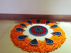Make a rangoli with flower petals and oil lamps. It will be lit! Simple Rangoli Designs Images, Rangoli Designs Flower, Flower Rangoli, Beautiful Rangoli Designs, Flower Mandala, Flower Designs, Flower Petals, Rangoli With Flowers, Easy Rangoli Designs Diwali