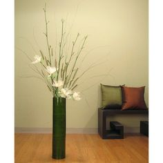 @Overstock - Ivory Lilies with 25-inch Bamboo Floor Vase - Color options: Dark greenMaterials: Bamboo and natural botanicals Plant type: Ivory lilies, tree leaves, basil ting, spring setaria    http://www.overstock.com/Home-Garden/Ivory-Lilies-with-25-inch-Bamboo-Floor-Vase/6167659/product.html?CID=214117 $54.99