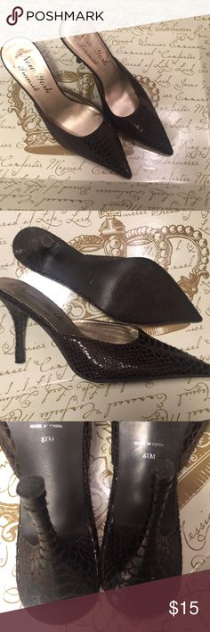 Size 8.5 slip on heels These chocolate brown faux snakeskin heels are great with any item. They were worn once. The heels are 3.5 inches 😉 new york transit Shoes Heels