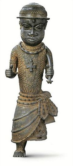 Figure of an Official or Attendant, early 17th century–18th century, Benin Kingdom, Nigeria. Bronze, copper alloy, 25 3/16 x 8 7/16 x 7 5/8 inches. University of Pennsylvania Museum of Archaeology and Anthropology, Philadelphia: Purchased from W. O. Oldman. Image courtesy of the Penn Museum, Image #250923. Photograph by Gary Ombler for Dorling Kindersley.