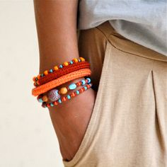 Love this! It's on memory wire! Wrap Crochet Cuff Bracelet in Orange, Rusty Brown and Aqua Blue.
