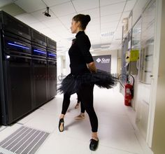 Photo of a dancer wearing tutu and pointe shoes, in a datacenter computer room, just in front of a EMC 2 Vmax storage unit. Funny, isn't it ?  :-)