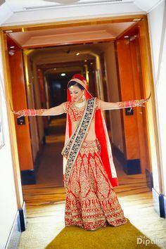 red and blue bridal lehenga , two dupattas, contrast dupatta, blue border, red all over raw silk bridal lehenga