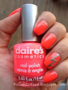 Neon Coral Mani with a Silver Lightning Bolt