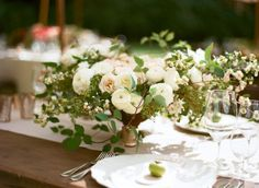 Gorgeous, garden roses, ranunculus, sweeping vines and herb foliage; by Ariella Chezar