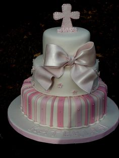girly Christening cake..bow was gumpaste/fondant and so was cross and flowers..all edible