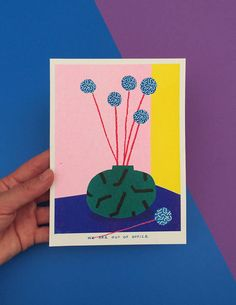 A risograph print of a small vase full of blue billy buttons