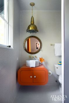 House Tour: Brookwood Hills - Design Chic - adore the orange paint color and nautical look of this children's bathroom