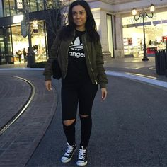 Comfortable and Cute Outfit. Black adidas Sweater,   Olive Bomber Jacket, Black denim, & converse shoes. By styledbyale