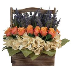Silk roses and hydrangeas with lavender in a handled wood basket.  Product: Faux floral arrangementConstruction Mate...