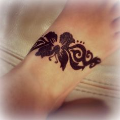 Cute butterfly tattoo I had done a while back on my foot. Done in Hena :)