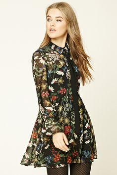 A semi-sheer woven swing dress featuring an allover floral print, partial  button front