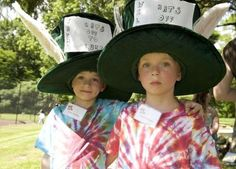 James Bradley, 5 1/2, of South Burlington, left, poses with his twin brother William, before winning third place in the Hat Parade and Contest at the Third Annual Mad Hatter's Tea and Bubbly, a fundraiser that benefits the Lund Family Center, at the Miller estate in South Burlington on Sunday, June 10, 2012.