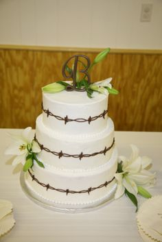 barbed wire wedding cakes   The cake was decorated with the receptions theme and topped with a ...