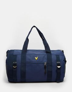 """Barrel bag by Lyle & Scott Woven, smooth outer Twin handles Detachable long strap Zip top closure Front pocket Buckle detailing Inner zipped compartment Wipe clean 100% Polyester H: 22cm/ 9"""" W: 42cm/ 17"""" D: 22cm/ 9"""""""