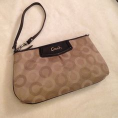 "Coach Wristlet Minor stains on the outside. Inside has small small markings on the very bottom. The stains on the outside are unnoticeable unless you're inspecting the Wristlet. Removable wrist piece to make a ""mini"" purse - or keep as a Wristlet.  priced according to stains. ❌PP Coach Bags"