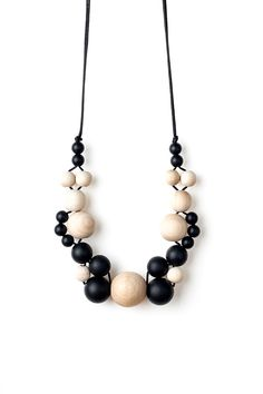 Geometric minimalist necklace by Black & Beech. Beautiful and unique teething jewellery, made with child-safe BPA-free food-grade silicone beads and untreated wooden beads. Diy Jewelry Necklace, Wooden Necklace, Leather Necklace, Jewelry Crafts, Beaded Jewelry, Jewelery, Handmade Jewelry, Beaded Necklace, Teething Jewelry