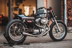 Our recent expedition to Northern Italy for the inaugural Wildays show gave us more than just ham-induced consumption, some sunburn and a flat track-related bung knee. It also provided us a chance meeting with Germany's Hookie Co., who had set up shop right alongside the Pipeburn display area. Bumming their shade, we got to talking over this, their latest build. It's a 1993 Harley XL883...