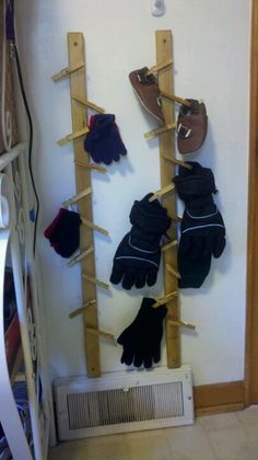 DIY CLOTHES PIN TREE placed by heat register to dry wet winter gear