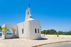 A Small White Church on the Seaside. Samos, Greece Travel, Landscape Architecture, Statue Of Liberty, Places Ive Been, Seaside, Mount Rushmore, Beautiful Places, Island