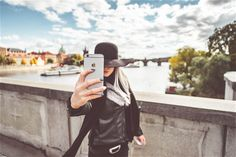 Young Woman Taking Selfie ➤ DOWNLOAD by click on the picture ➤ #Woman #Hat #Girl #Hands #Iphone #Iphone6 #Mobile #Fashion #People #Phone #Selfie #Prague #CharlesBridge #Autumn #Traveling #freestockphotos #picjumbo
