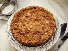 Chocolate-Almond Cheesecake : With a buttery graham cracker-almond crust, a gooey center of chocolate-laced cream cheese and a crispy topping of sliced almonds and brown sugar, Giada's party-perfect cheesecake boasts layer upon layer of decadent flavor.