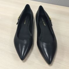 Ivanka Trump Black Flats with Gold Worn once.  In excellent condition.  No box. Ivanka Trump Shoes Flats & Loafers