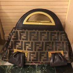Vintage Fendi Bag There is scratching on gold hardware it's missing a shoulder strap I never carried it with this bag really cute I bought at a high end resale store years ago no wear on fabric it is authentic ! I FENDI Bags Satchels