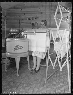 """""""Farm Woman using her electric mangle"""" (J. M. Butzko, Montgomery County, Indiana, August 12, 1930) Between World War I and II, laborsaving machinery changed housework. Electric washing machines, mangles (a machine for pressing cloth), irons, and vacuum cleaners made individual tasks much easier, but higher standards of cleanliness, fewer domestic workers, and increased responsibilities associated with childcare made more work for homemakers and mothers."""