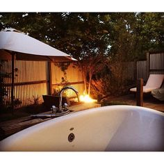 The perfect end to a day enjoying Napa Valley- a long soak in an outdoor tub and a glass of wine by the fire. Photo: @heatherlylie #perfection #wine-dingdown #happyplace #carnerosinn #lovely #relax #serene #vacation #soak #bath #tub #fire #love #amazing