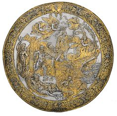 Italian, 16th Century Parade Shield with the Apotheosis of Charles V, Italy, c. 1535–1540 etched and embossed steel; gold and silver Patrimonio Nacional, Real Armería, Madrid,