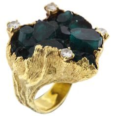 Oversize 18K yellow gold and Chatham emerald crystal ring is Ed Wiener's signature style, circa 1980's.