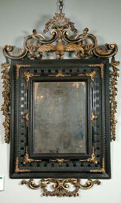 An Early 18th Century Venetian Ebonised & Parcel Gilt Mirror.