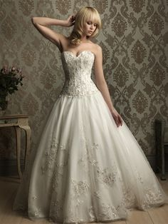 stunning--i love how the embroidery flowers and such make it look like they are hiding a corset. i love love love this