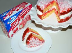 wpurp-searchable-recipeRaspberry Zinger Cake - A delicious two-layer vanilla pudding cake, soaked in raspberry Jell-O, filled with marshmallow cream, then smothered with coconut! Um, Yes Please! Pudding Desserts, Vanilla Pudding Cake, Marshmallow Creme, Marshmallow Frosting, Jell O, Zinger Cake Recipe, Cake Mix Recipes, Dessert Recipes, Raspberry Zinger Cake