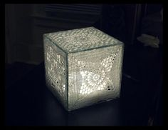 Ravelry: Chamellines Crochet light box. See http://www.ravelry.com/projects/Chamelline/crochet-light-box