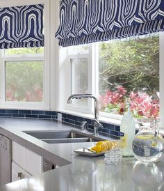 Window treatments in kitchens #interior #decor  Nothing brightens up a kitchen like a vibrant and funky part of blue and white patterned window blinds. Nautical is all the rage too at the moment!